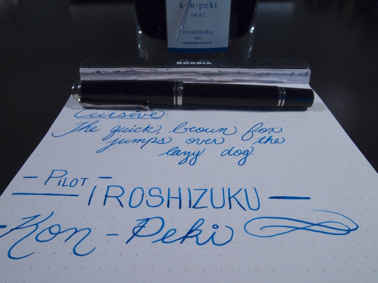 Rhodia dotPad, Pelikan M605, and the bottle of Pilot Iroshizuku Kon-Peki. A wonderful combination.