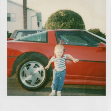 Me rocking out in front of my dad's Corvette.